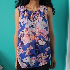 blue sleeveless floral blouse